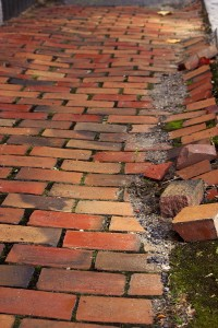 bigstockphoto_Cracked_Brick_Walkway_5948916