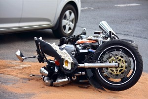 bigstockphoto_Motorbike_Accident_On_The_City_6599523